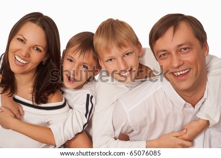 beautiful family of four on a light background