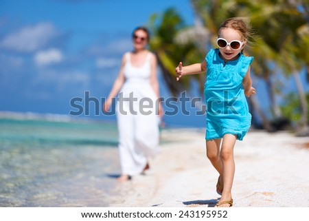 Beautiful family of mother and daughter enjoying vacation at tropical island - stock photo