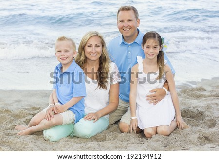 Beautiful Family portrait at the beach - stock photo