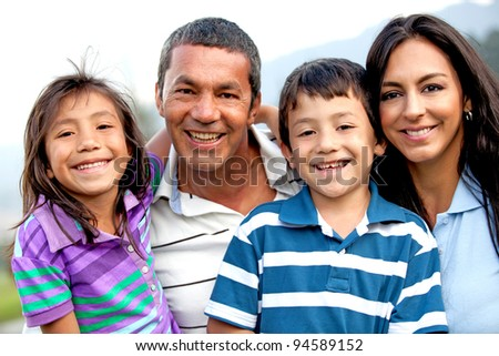 Beautiful family portrait looking happy and smiling outdoors - stock photo