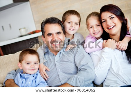 Beautiful family portrait relaxing at the living room at home - stock photo