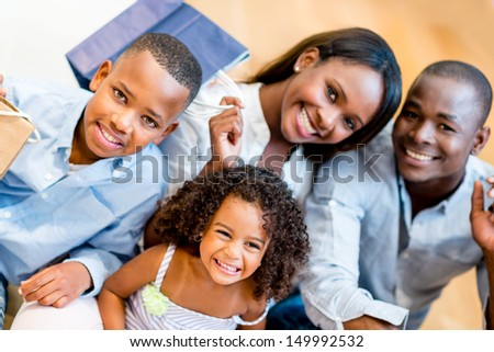 Beautiful family portrait shopping at the mall  - stock photo