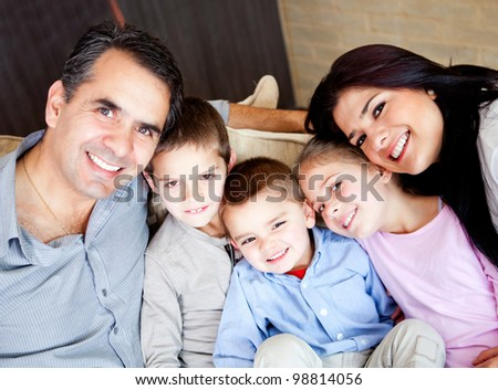 Beautiful family portrait smiling indoors at home - stock photo