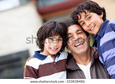 Beautiful family portrait with a group boys smiling - stock photo