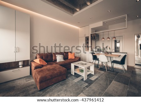 Beautiful family room in private residence with open kitchen in background - stock photo
