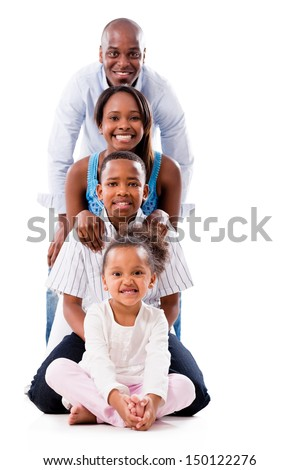 Beautiful family smiling and looking very happy - isolated over white