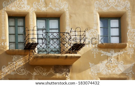 Beautiful, fancy, wrought-iron balconies and two windows.Spain.