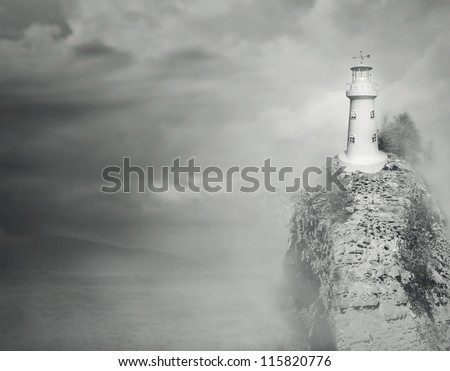 Beautiful fantasy background of a lighthouse on the top of a rocky mountain with sea and cloudy sky in black and white - stock photo