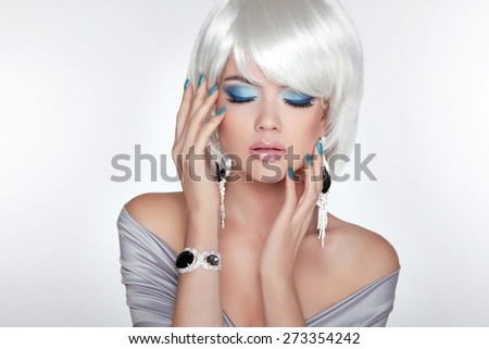 Beautiful fashion blond girl with bob hair. Makeup. Jewelry. Short straight hair Shine with health. - stock photo