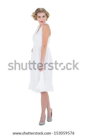 Beautiful fashion blonde model looking at camera on white background - stock photo