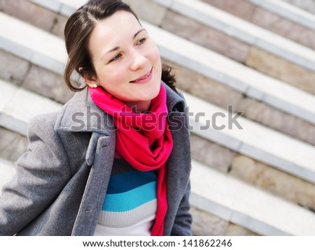 beautiful fashion girl sitting on the steps - stock photo