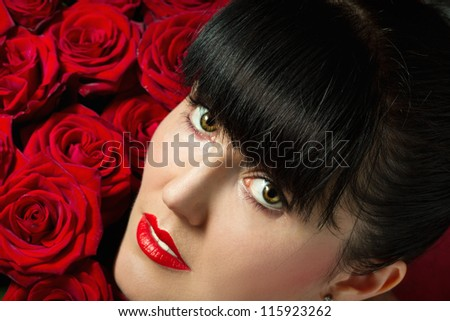 Beautiful Fashion Girl with red makeup and Roses.