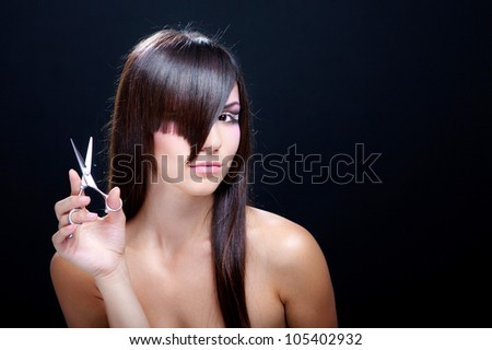 Beautiful fashion girl with scissors