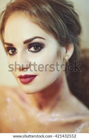 Beautiful Fashion Luxury Makeup, long eyelashes, perfect skin facial make-up. Beauty Brunette model woman holiday make up close up. Eyelash extensions, false eyelashes. - stock photo