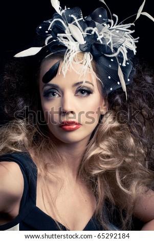 Beautiful fashion model, classic retro style look, studio portrait - stock photo
