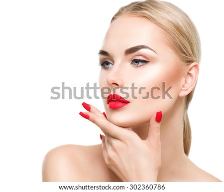 Beautiful fashion model girl with blond hair. Red lipstick and nails. Portrait of glamour woman with bright makeup isolated on white background. Beauty female face close up with perfect make up - stock photo