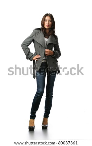 Beautiful fashion model in autumn clothes isolated on white background - stock photo
