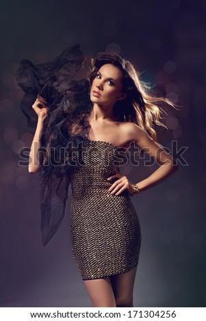 Beautiful fashion model in golden dress. Vogue.  - stock photo