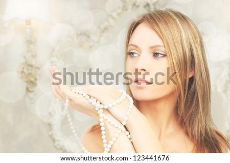 Beautiful fashion model in royal interior, portrait - stock photo