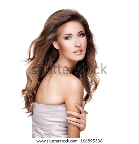 Beautiful fashion model with gorgeous long hair and makeup posing at studio. Isolated on white background.