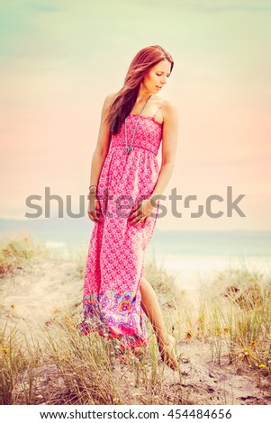 Beautiful fashion model woman at the beach - stock photo