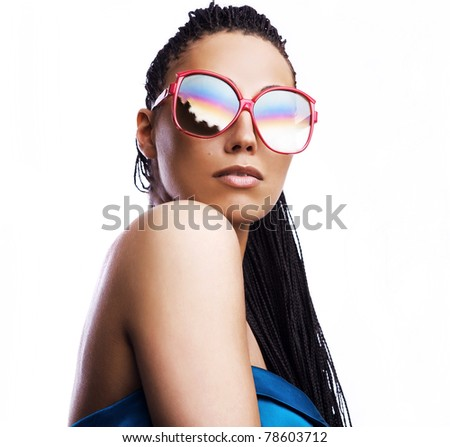 beautiful fashion mulatto woman wearing sunglasses over a white background. - stock photo