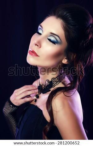 beautiful fashion vampire victorian style woman posing over dark background fashion toning - stock photo