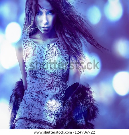 Beautiful fashion woman. Color face art photo toned blue.
