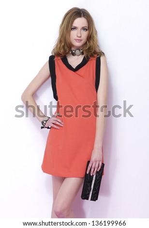 beautiful fashion woman holding purse posing - stock photo