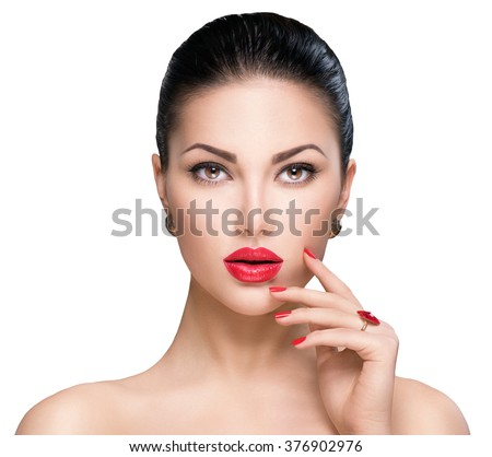 Beautiful Fashion woman model face portrait with red lipstick and red nails. Glamour girl with bright makeup isolated on white. Beauty female. Perfect skin and make up. Red lips and nail polish - stock photo