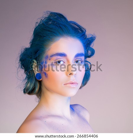Beautiful fashion woman with bright color face art. Paint on face. Creative portrait - stock photo