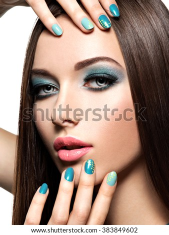 Beautiful fashion woman with turquoise make-up and nails  - on white background - stock photo