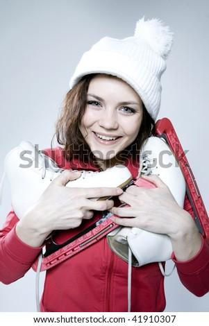 beautiful fashionable girl with skates - stock photo