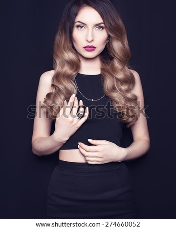 Beautiful fashionable glamor girl posing in the studio