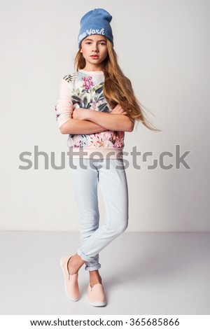 beautiful fashionable kid girl  isolated on white - stock photo