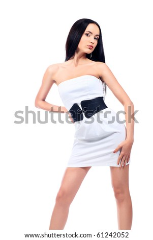 Beautiful fashionable woman in a white dress. Isolated over white background. - stock photo