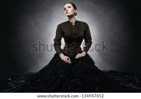 Beautiful fashionable woman in gothic style - stock photo