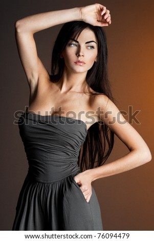 beautiful fashionable woman in grey clothes - stock photo