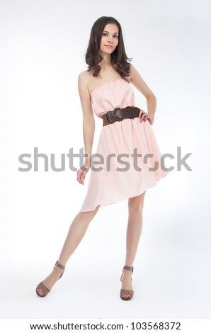 Beautiful fashionable woman in modern dress posing - series of photos. Sales concept - stock photo