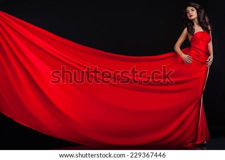 beautiful fashionable woman in red dress - stock photo