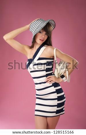 Beautiful fashionable woman posing in studio - stock photo