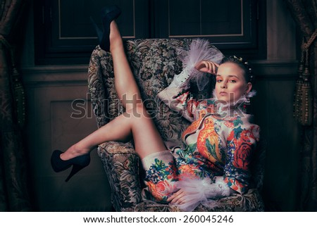Beautiful fashionable woman  with lovely legs - stock photo