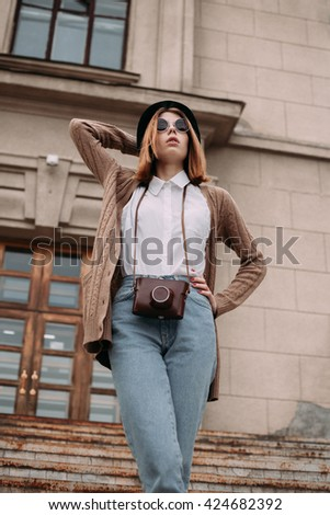 Beautiful fashionable woman with round glasses. bottom view