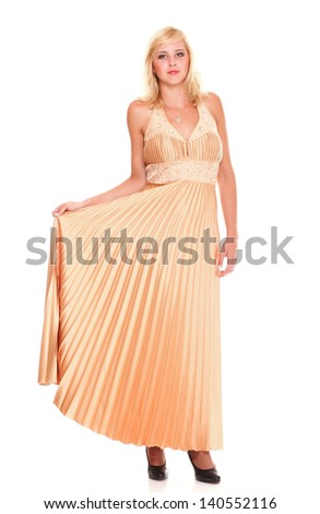 Beautiful female blonde fashion model in yellow dress isolated over white background - stock photo