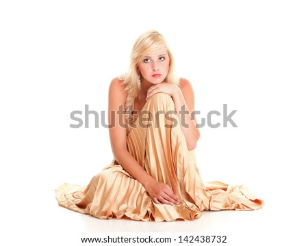 Beautiful female blonde fashion model in yellow dress isolated over white background
