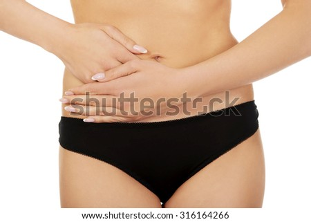Beautiful female body in black panties,isolated on white - stock photo