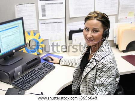 Beautiful female call center operator, headset customer service in a real situation not everyday isolation image