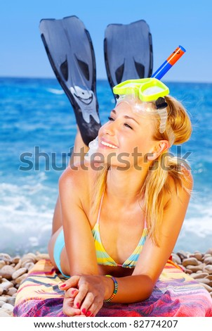 Beautiful female closeup portrait on the beach wearing snorkeling equipment, water sport, healthy lifestyle concept - stock photo