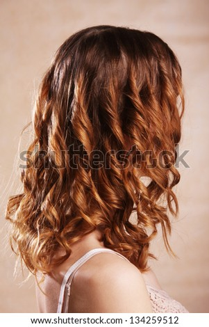 Beautiful female curly red hairs - back view