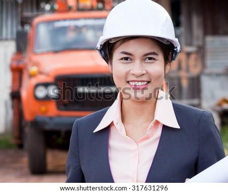 Beautiful female engineer. - stock photo